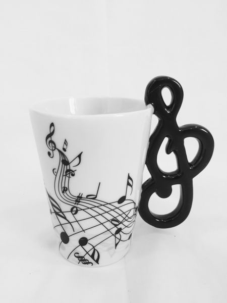 Coffee mug decorated with musical notes with violin handle